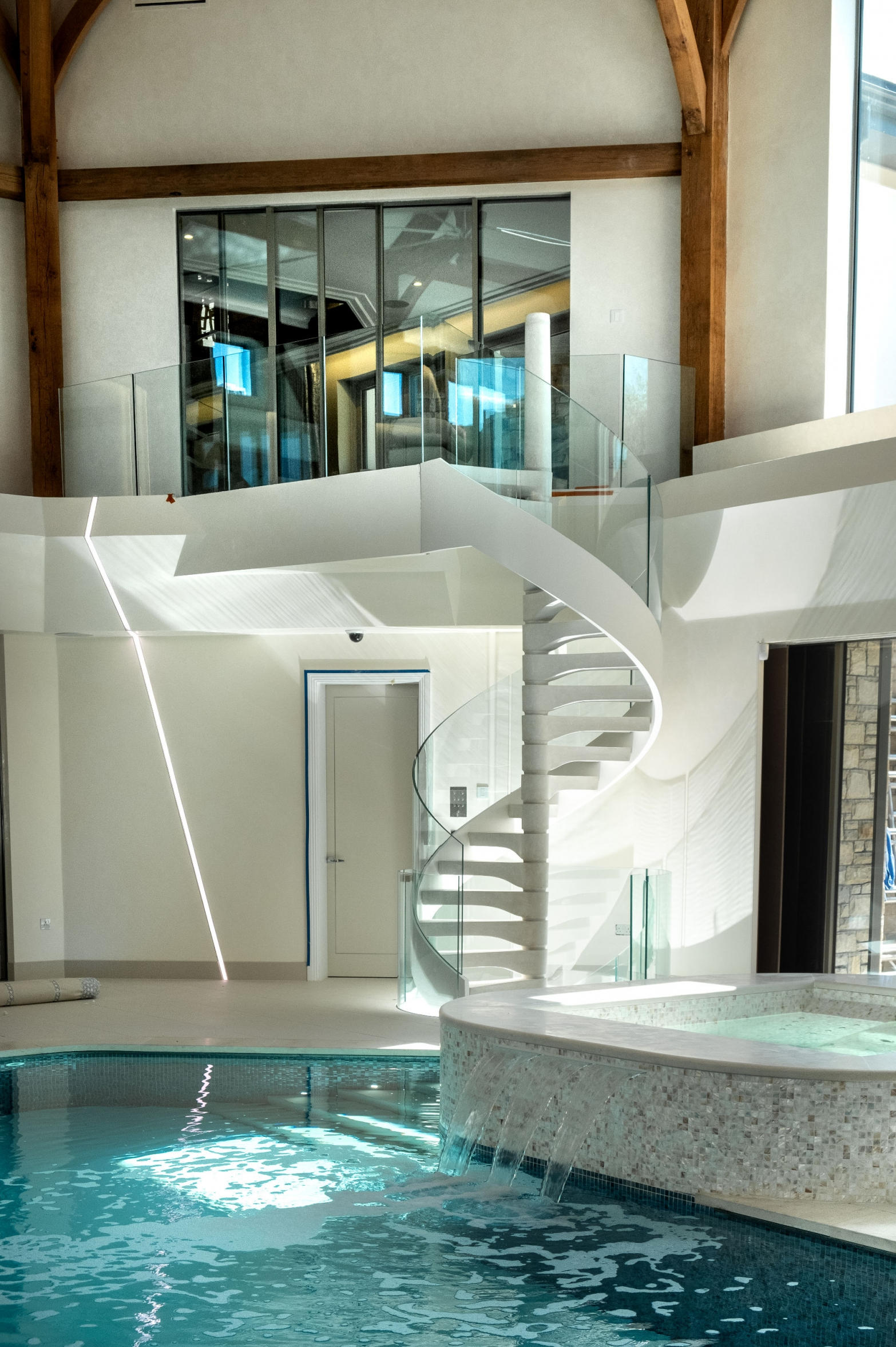Spiral Staircase leading to a Swimming Pool