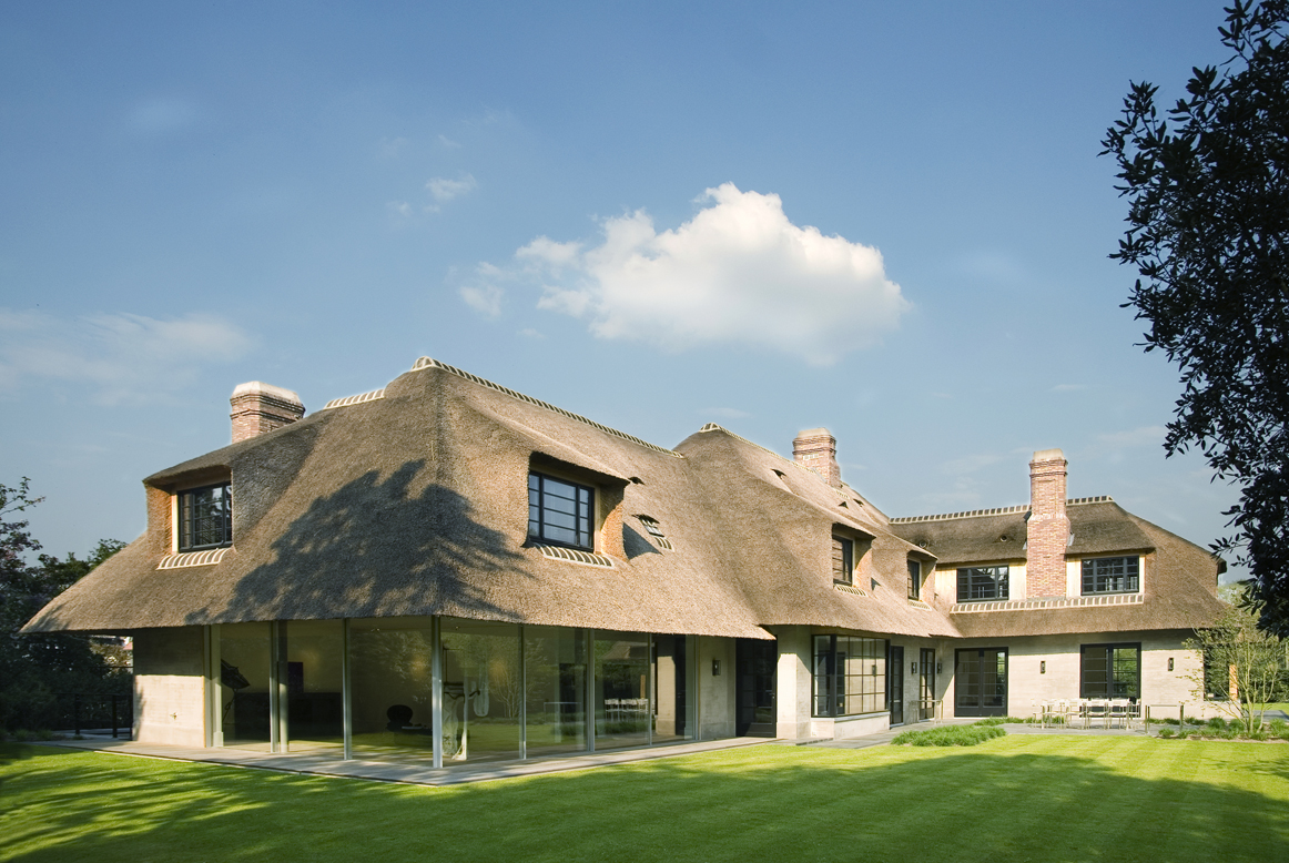 an historic building renovation with a thatched roof
